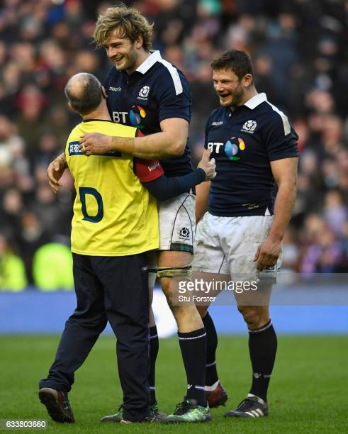 Scotland players Richie Gray and Ross Ford celebrate with Doctor Robson after the RBS Six Nations match between Scotland and Ireland at Murrayfield...
