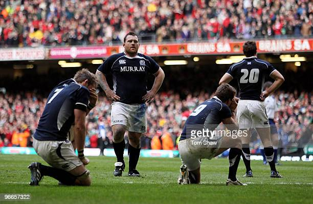 Scotland players show their dejection following defeat in the RBS 6 Nations match between Wales and Scotland at the Millennium Stadium on February 13...