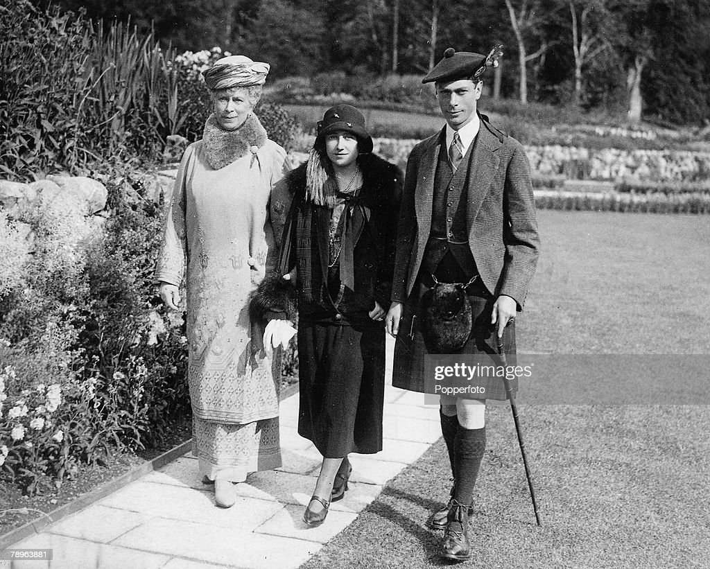 Scotland. 1924. Queen Elizabeth (later the Queen Mother) pictured when she was the Duchess of York with her husband the Duke of York (later King George VI) and Queen Mary in the gardens at Balmoral Castle, Scotland. : News Photo