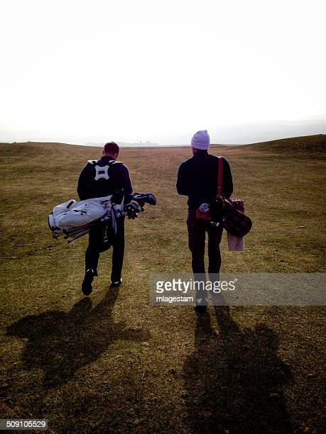 Scotland, Rear view of two golfers