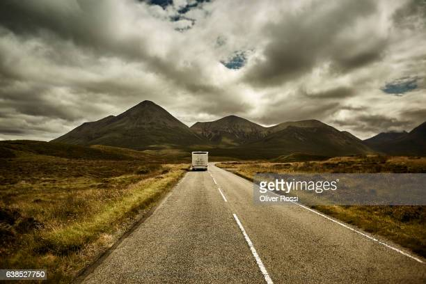 uk, scotland, recreation vehicle on country road - camper van stock pictures, royalty-free photos & images
