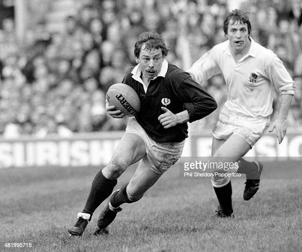 Scotland scrumhalf Roy Laidlaw being chased by Steve Smith of England during the Five Nations International match between England and Scotland at...