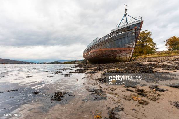 UK, Scotland, ship wreck run aground next to Fort William in the Scottish Highlands