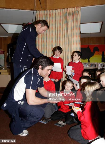 Scotland squad members Kelly Brown and Craig Hamilton sign autographs at Balmullo Primary School