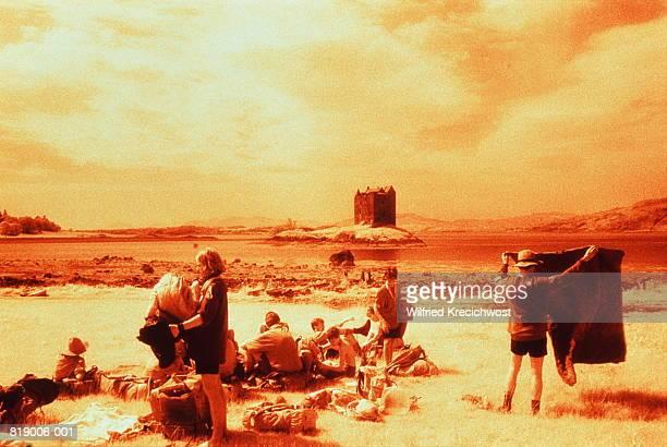 Scotland, Strathclyde, Castle Stalker,family picnicking,infrared