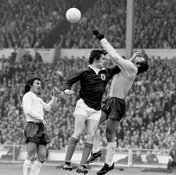 Scotland striker Joe Jordan clashes with England goalkeeper Peter Shilton watched by Roy McFarland during the British Championship International...