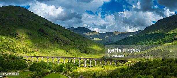 scotland sunlight on highland mountain glen glenfinnan viaduct panorama lochaber - scotland stock pictures, royalty-free photos & images