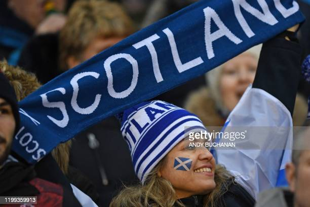 A Scotland supporter holds up her scarf in teh crowd ahead of the Six Nations international rugby union match between Scotland and England at...