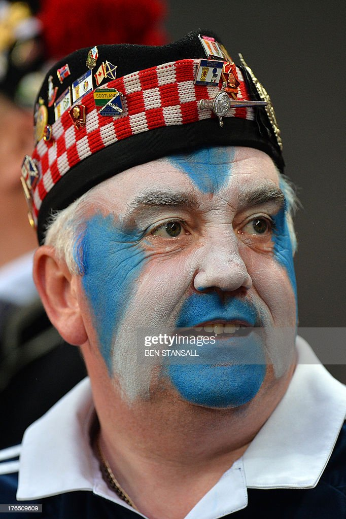 A Scotland supporter waits for kick off of the international friendly football match between England and Scotland at Wembley Stadium in London on August 14, 2013.