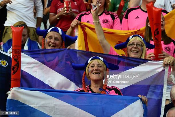 Scotland supporters cheer for their team during the UEFA Women's Euro 2017 football match between England and Scotland at the Galgenwaard Stadium in...