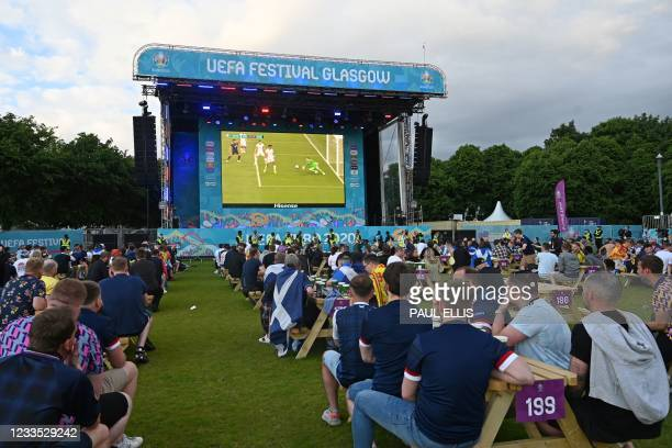 Scotland supporters cheer on their team at the Fan Zone in Glasgow while watching the UEFA EURO 2020 football match between England and Scotland...