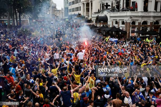 Scotland supporters gather in Leicester Square in central London ahead of the UEFA Euro 2020 European Football Championship football match between...