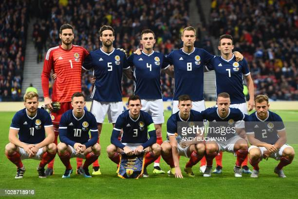Scotland team back row Scotland's goalkeeper Craig Gordon Scotland's defender John Souttar Scotland's defender Charlie Mulgrew Scotland's midfielder...