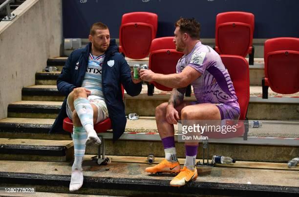 Scotland teammates Finn Russell of Racing 92 and Stuart Hogg of Exeter Chiefs share a drink after the Heineken Champions Cup Final match between...