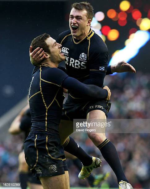Scotland teammates Tim Visser and Stuart Hogg celebrate their team's victory as the final whistle blows during the RBS Six Nations match between...