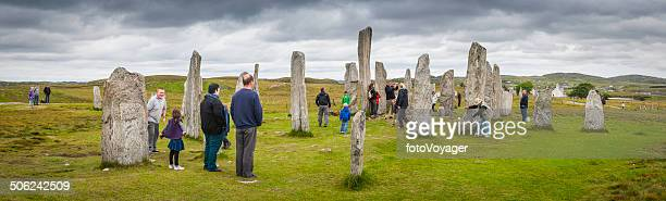 scotland tourists sightseeing at callenish stone circle outer hebrides panorama - stonehenge stock photos and pictures