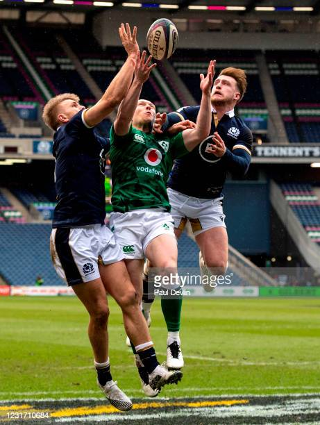 Scotland , United Kingdom - 14 March 2021; Keith Earls of Ireland competes for a high ball against Chris Harris, left, and Stuart Hogg of Scotland...