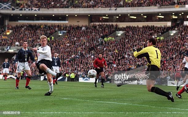 Scotland v England at Hampden Park Paul Scholes beats Neil Sullivan to score England's first goal
