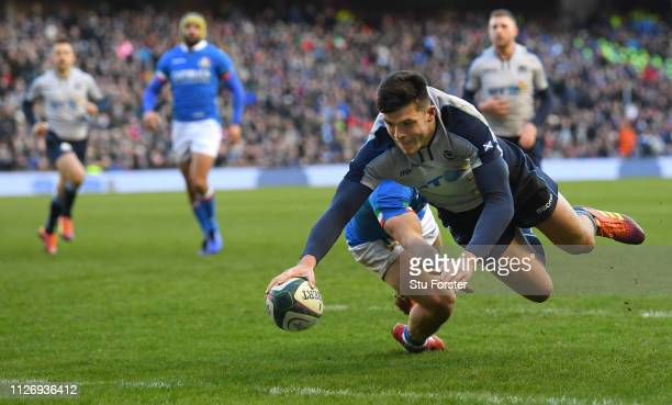 Scotland wing Blair Kinghorn dives over for his second try during the Guinness Six Nations Championship match between Scotland and Italy at...