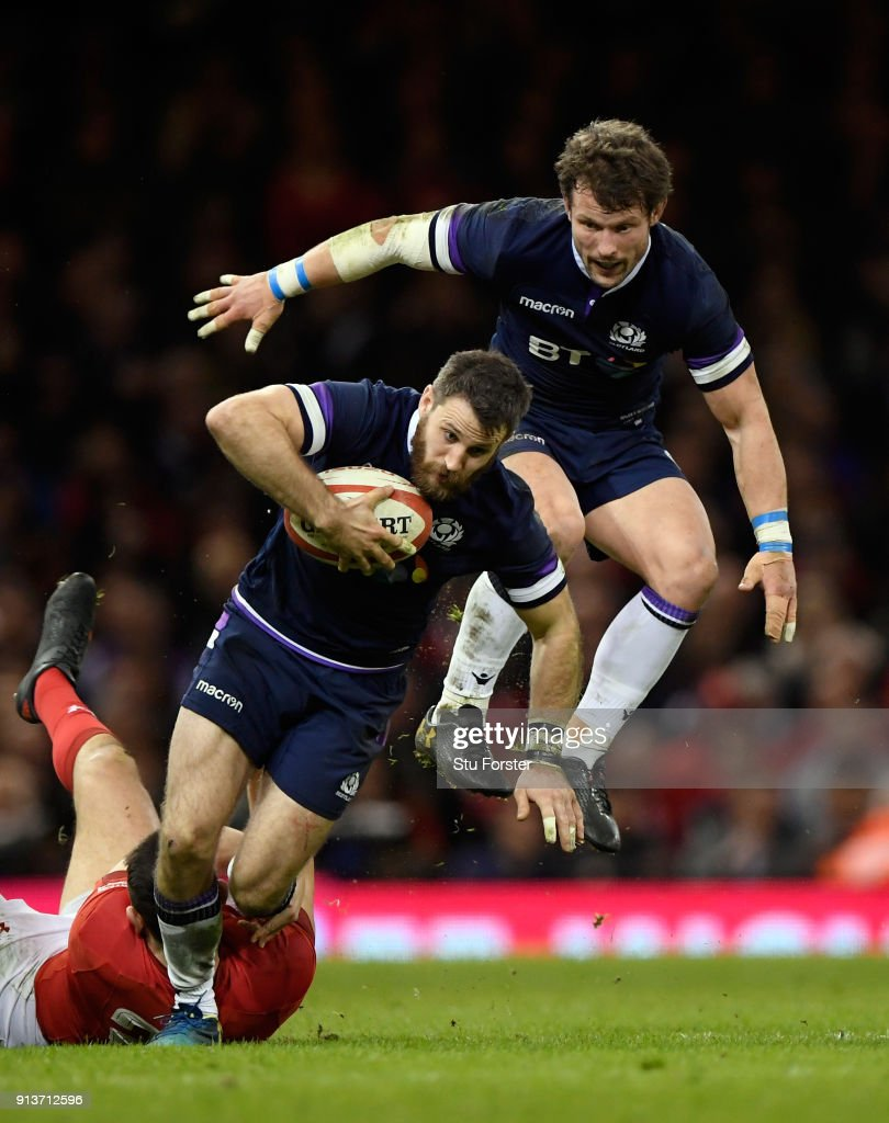 Scotland wing Tommy Seymour is brought down by Wales player Owen Watkin as Peter Horne of Scotland follows behind during the NatWest 6 Nations game between Wales and Scotland at Principality Stadium on February 3, 2018 in Cardiff, Wales.
