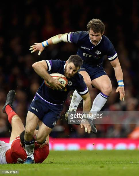 Scotland wing Tommy Seymour is brought down by Wales player Owen Watkin as Peter Horne of Scotland follows behind during the NatWest 6 Nations game...