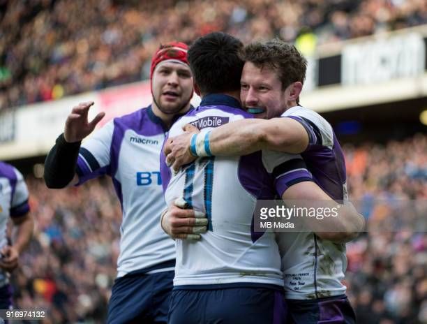 Scotland winger Sean Maitland is mobbed by teammates after scoring his side's opening try during the NatWest Six Nations match between Scotland and...