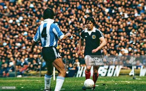 Scotland winger Willie Johnston runs at an Argentina defender during a friendly International between Aargentina and Scotland at the Boca Juniors...