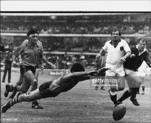 Scotland/Australia Union 2nd Test at SCGIn blinding rain Australian halfback ***** ball under the watchful eye of referee Dick Byers July 10 1982