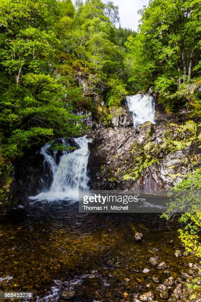 scotland-chia-aig waterfall and witches pool - brook mitchell stock pictures, royalty-free photos & images
