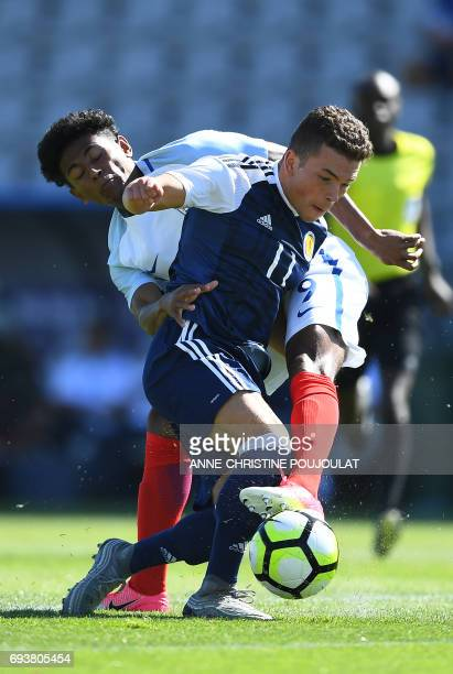 Scotland's Adam Frizzell outruns England's Demetri Mitchell during the Under 21 international football semi final match Scotland vs England at the...