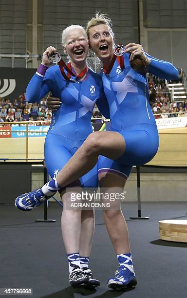 Scotland's Aileen McGlynn and Louise Haston pose for pictures after winning the silver medal in the women's 1000m time trial B2 tandem track cycling...