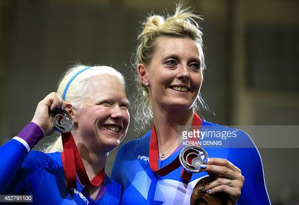Scotland's Aileen McGlynn and Louise Haston pose on the podium after winning the silver medal in the women's 1000m time trial B2 tandem track cycling...
