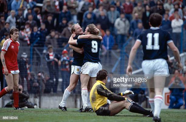 Scotland's Alan Brazil is congratulated by Andy Gray after scoring the 2nd goal during the Wales v Scotland British Championship game in Cardiff on...