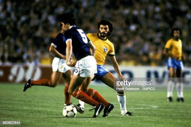 Scotland's Alan Hansen takes on Brazil's Socrates