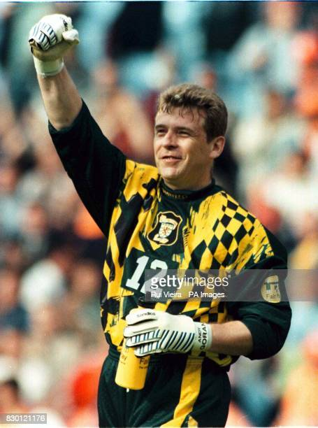 Scotland's Andy Goram celebrates his team's 00 draw with Holland after their EURO '96 group match at Villa Park 26/5/98 Goram quits international...