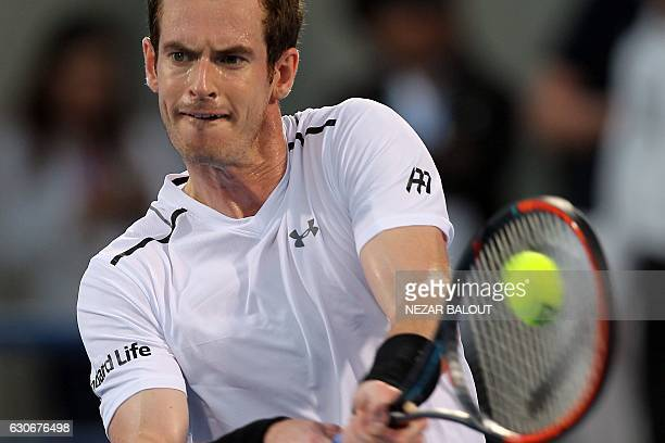 Scotland's Andy Murray returns the ball to Belgium's David Goffin during their semifinal match in the Mubadala World Tennis Championship in Abu Dhabi...