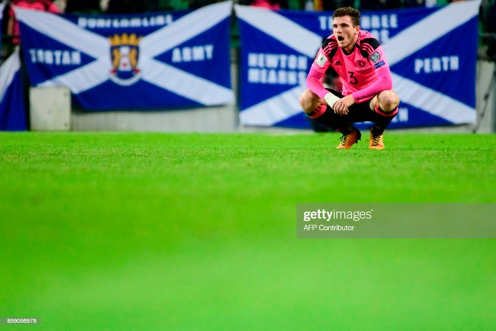 Scotland's Andy Robertson reacts after the draw during the FIFA World Cup 2018 qualifier football match between Slovenia and Scotland at the Stozice stadium in Ljubljana, on October 8, 2017. / AFP PHOTO / Jure Makovec