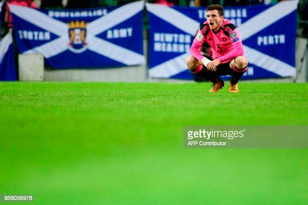 Scotland's Andy Robertson reacts after the draw during the FIFA World Cup 2018 qualifier football match between Slovenia and Scotland at the Stozice...