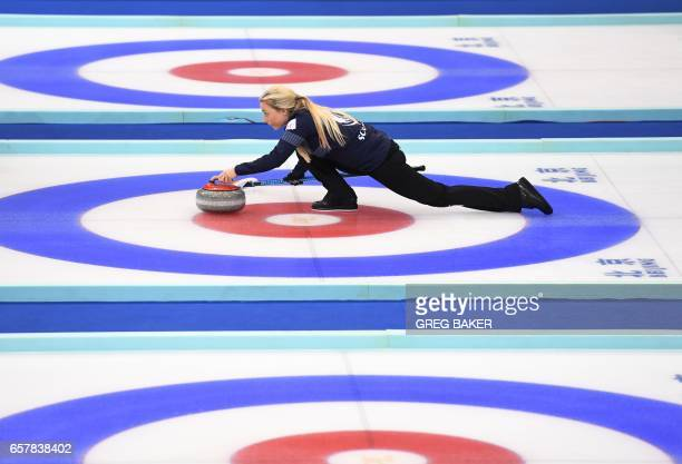 Scotland's Anna Sloan releases the stone during their bronze medal match against Sweden at the Women's Curling World Championships in Beijing on...