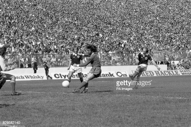 Scotland's Archie Gemmill fires the opening goal past Northern Ireland's Pat Jennings and Peter Scott watched by teammate Kenny Dalglish