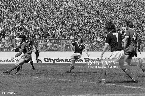 Scotland's Archie Gemmill fires the opening goal past Northern Ireland's Peter Scott watched by teammate Kenny Dalglish and Northern Ireland's Chris...