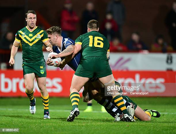 Scotland's Ben Hellewell is tackled by Australia's Trent Merrin and Jake Friend during the Four Nations match between the Australian Kangaroos and...