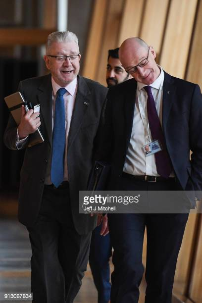 Scotland's Brexit secretary Michael Russell and John Swinney Deputy First MinisterÊattend first ministers questions in the Scottish Parliament on...
