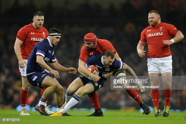 Scotland's Byron McGuigan is tackled by Wales' Cory Hill during the NatWest Six Nations Championship match between Wales and Scotland at Principality...