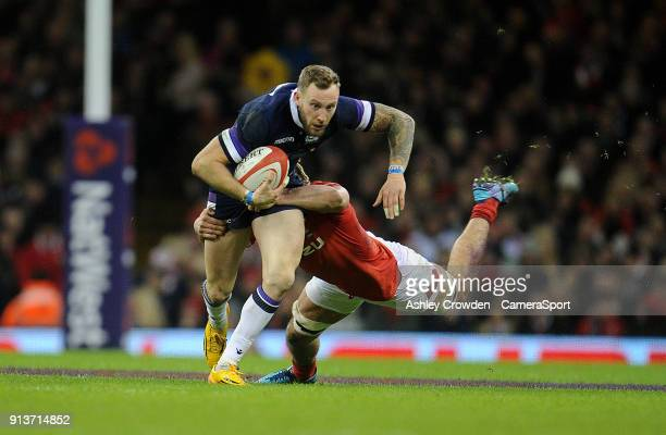 Scotland's Byron McGuigan is tackled by Wales' Josh Navidi during the NatWest Six Nations Championship match between Wales and Scotland at...