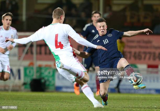 Scotland's Callum McGregor challenges Hungary's Adam Lang during the International Friendly at Tannadice Park Dundee