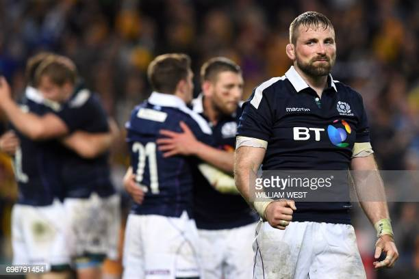 TOPSHOT Scotland's captain John Barclay celebrates beating Australia in their rugby union Test match in Sydney on June 17 2017 Scotland pulled off a...
