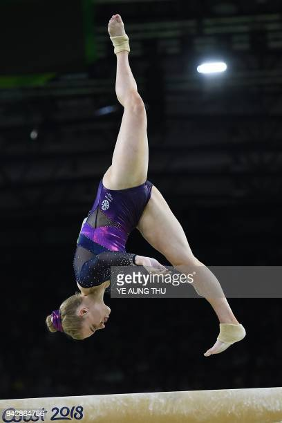 Scotland's Cara Kennedy competes on the balance beam during the women's individual allaround final in the artistic gymnastics event during the 2018...