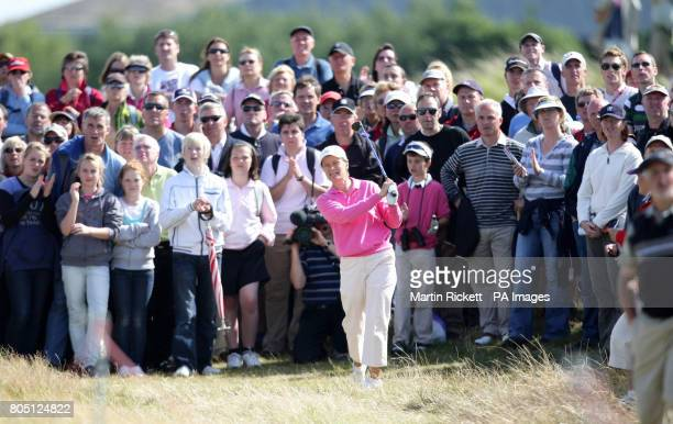 Scotland's Catriona Matthew plays from the path off the 14th fairway during the Women's British Open at Royal Lytham and St Anne's Golf Course...