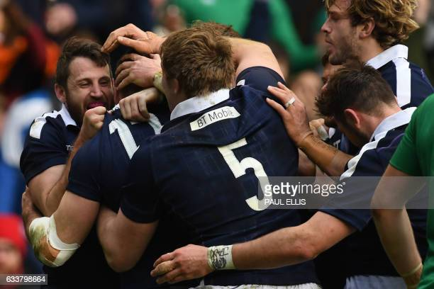 Scotland's center Alex Dunbar celebrates with teammates after scoring their third try during the Six Nations international rugby union match between...